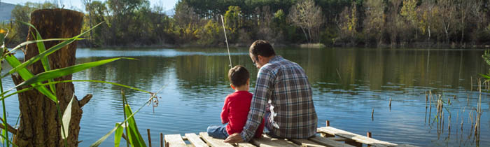 Dad fishing with child