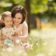 Mother and daughter playing in a field of flowers